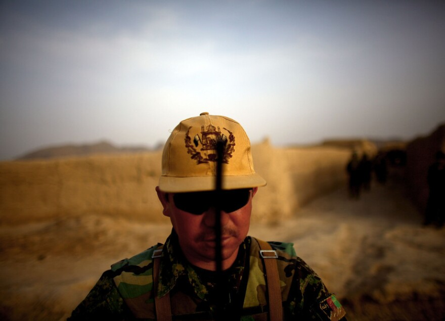 Afghan National Army platoon Sgt. Hyatulla Hakimi watches over his men while on a joint patrol.