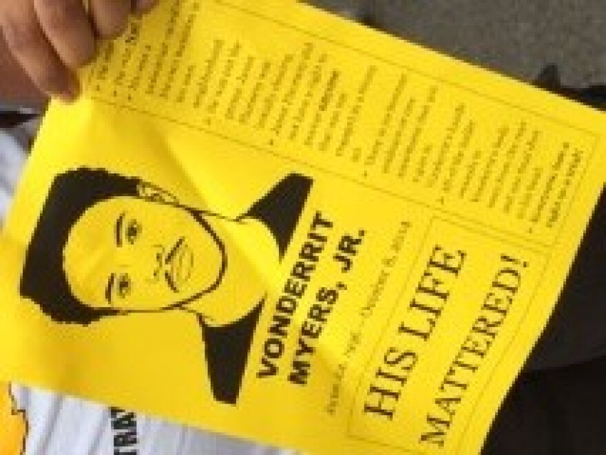 A flyer carried by some marchers at the event in memory of VonDerrit Myers Jr.