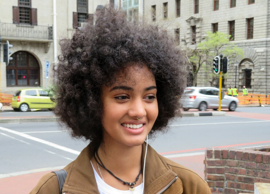 """Zia Simpson, a student and sales assistant in Cape Town, says even her father tells her to tame her Afro. """"That generation fought against apartheid, but they still carry around the mentality that green eyes look better on a person, that straight hair looks better on a person."""""""