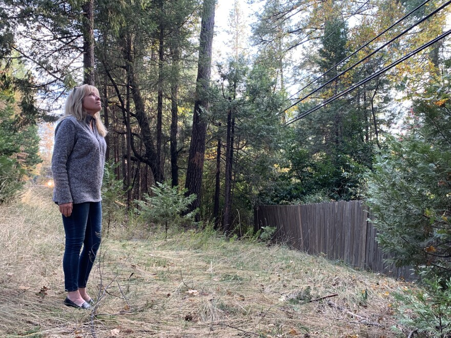 Magalia resident Tammy Waller says it's unbelievable that even after the deadliest wildfire in California history was ignited by PG&E's faulty equipment, there are still power lines in her neighborhood perilously close to dense strands of trees and brush.