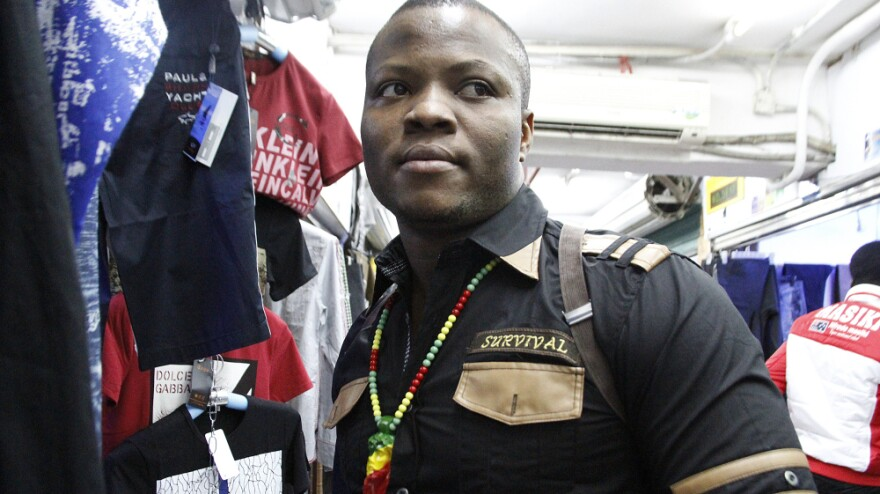"""In the southern Chinese city of Guangzhou, thousands of African immigrants, many of them small-scale clothing traders from Nigeria, have come seeking business opportunities. One of the Nigerian traders, who goes by his """"designer name"""" of Niceguy, is shown here in the city's Little Africa neighborhood."""