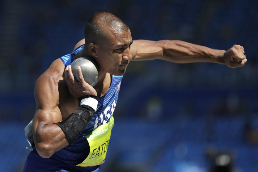 American Ashton Eaton competes in the shot put as part of day one in the decathlon in Rio on Wednesday. Eaton, the reigning Olympic champion and world record holder in the decathlon, is favored to repeat.