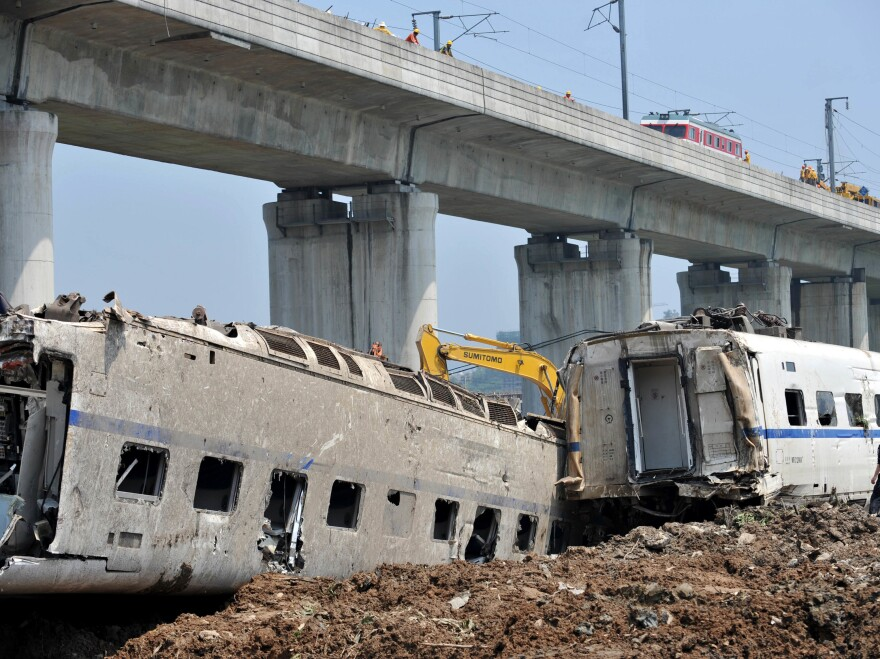 Workers prepare to clear away wrecked train cars in Wenzhou, in China's Zhejiang province, after the crash of a bullet train in 2011.