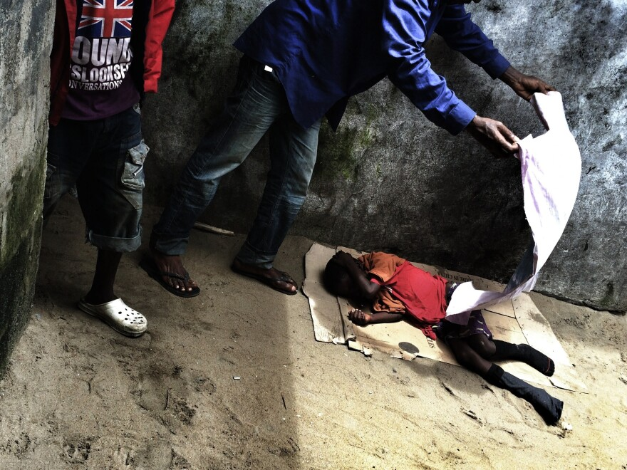 Ten-year-old Saah Exco was found on a beach in Liberia's West Point slum, abandoned and naked, a likely Ebola victim. Our photographer made a picture and hoped the child would recover. A day later, the boy died.