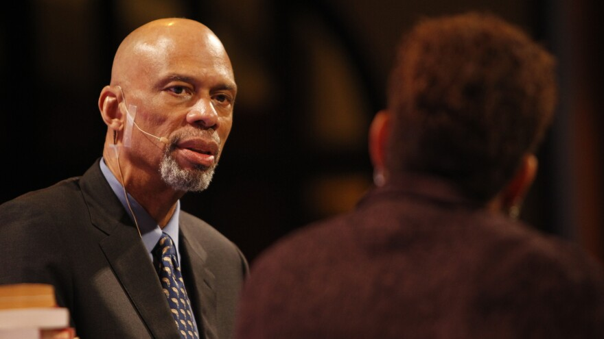 Kareem Abdul-Jabbar talks with NPR's Michel Martin on Friday at the National Building Museum in Washington, D.C.