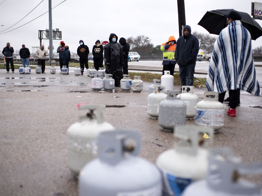 People in Houston wait in line to fill their propane tanks on Wednesday amidst widespread power outages related to the winter storm. Cases of carbon monoxide poisoning in the state have increased in recent days, with officials attributing most to the improper use of heating devices like charcoal grills and portable generators.