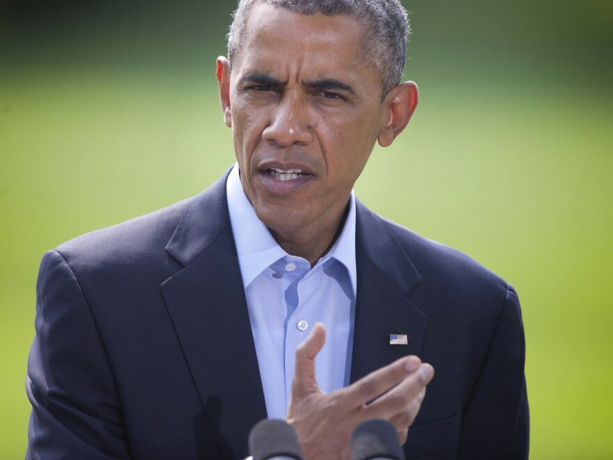"""President Obama speaks on the South Lawn of the White House in Washington, on Saturday. He said the situation in Iraq amounts to a """"long-term project."""""""