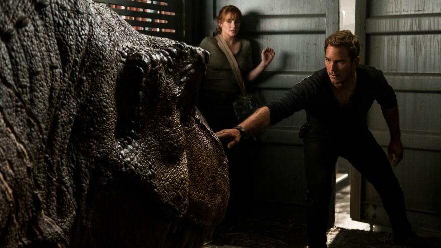 Sleep Dino More: Claire (Bryce Dallas Howard) and Owen (Chris Pratt) try not to wake one of Isla Nublar's grumpiest residents in <em>Jurassic World: Fallen Kingdom</em>.