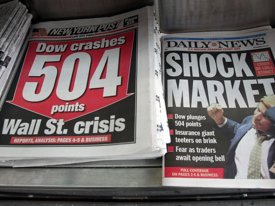 Newspapers are seen for sale at a newsstand Sept. 16, 2008, in New York City. U.S. stocks were mixed after the Dow Jones industrial average plunged 4.4 percent or 504 points.