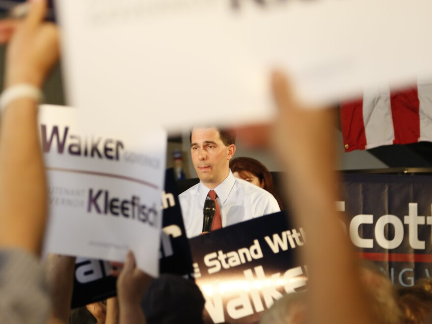 Republican Wisconsin Gov. Scott Walker campaigns Thursday with Louisiana Gov. Bobby Jindal in Waukesha, Wis.