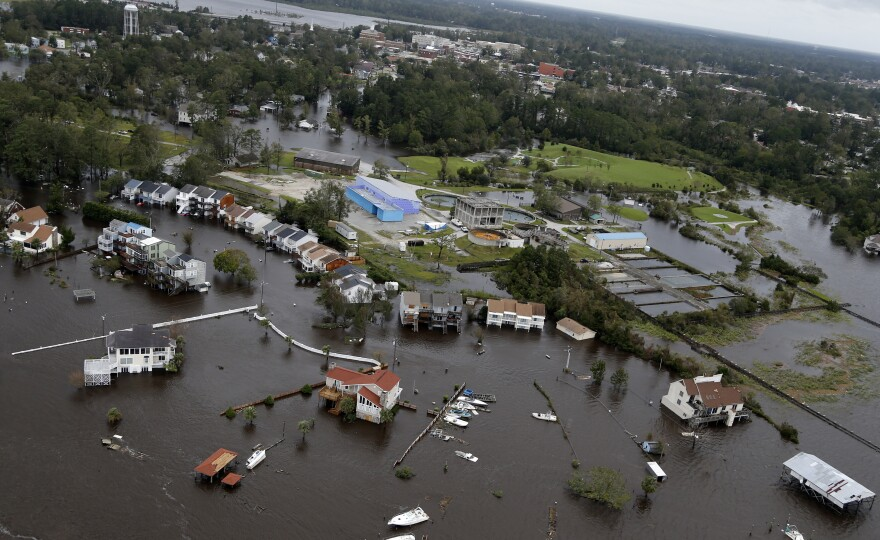 Homes and a marina in Jacksonville, N.C., are flooded Sunday as a result of high tides and rain from Florence, which moved through the area.
