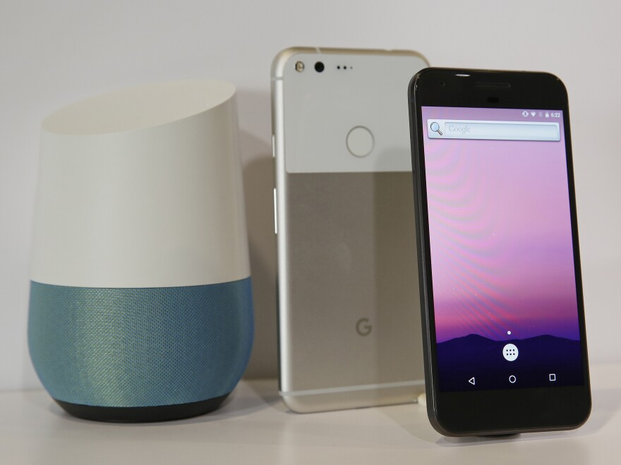 The Google Home speaker and the Google Pixel phone. (AP Photo/Eric Risberg)