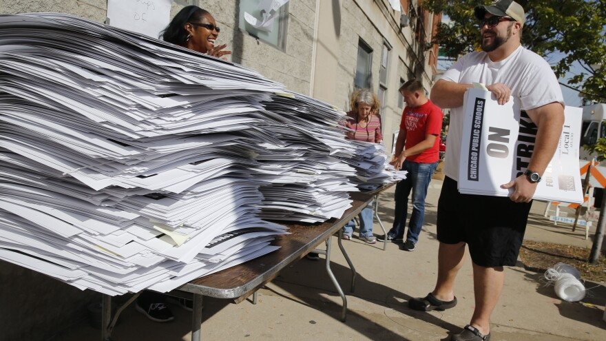 A tentative contract was reached between the Chicago Teachers Union and the Chicago Public Schools. But just in case things didn't work out, stacks of picket signs were ready for pick-up outside the union's strike headquarters on Monday.