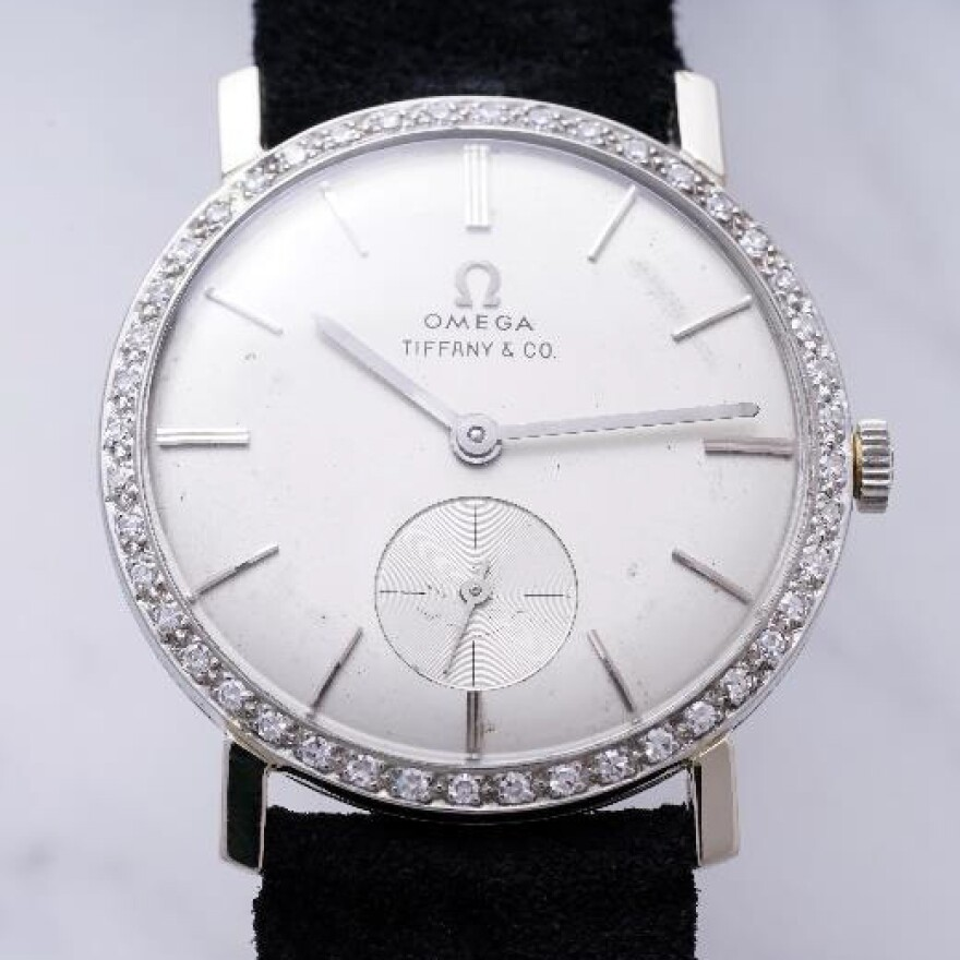 The watch features an 18k white gold case with forty-four diamonds encircling the face.