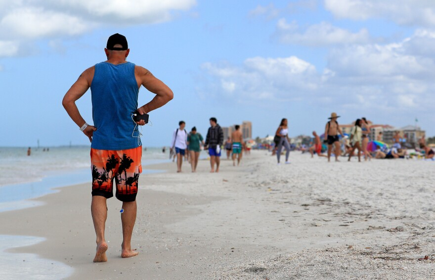 People continued to gather on Florida beaches such as Clearwater Beach after the coronavirus had already started to spread in the U.S. On March 20, the city of Clearwater ordered all its public beaches to close. As of Friday, Florida has more than 2,400 confirmed coronavirus cases and 29 deaths.