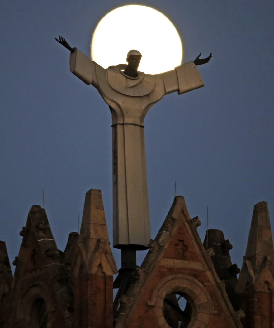 The moon rises behind a church in the Pittsburgh Diocese, one of six dioceses mentioned in the massive report on sexual abuse among Pennsylvania clergy.