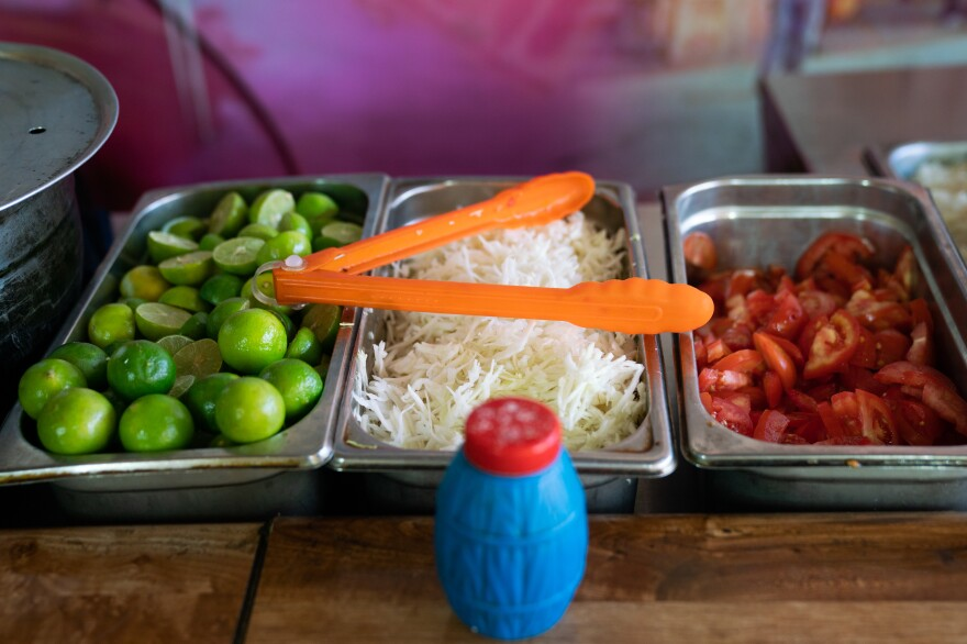 Fresh limes, cabbage and tomatoes sit on the counter as the restaurant prepares for the lunch rush.
