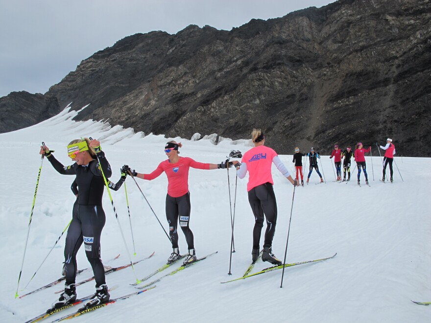 Skiers Jessie Diggins (from left), Kikkan Randall and Sadie Bjornsen finish practice. During the summer, they ski on Eagle Glacier to prepare for competition. It's one of the few places where skiers can train on snow during the summer.