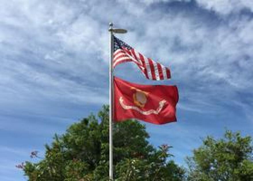 The American Flag and U.S. Marine Corps flag fly outside the Katter's home. Their son, Hunter, followed his father's legacy and joined the Marines.