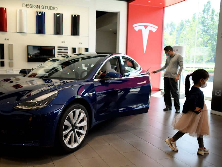 A Tesla car is on display at a showroom in Beijing on May 10. Tesla's stock has soared from $430 a share at the start of 2020 to nearly $1,600 at Wednesday's close.