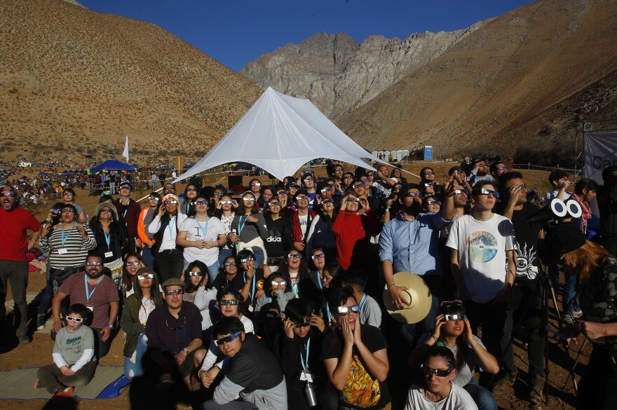 Chileans in Paiguano watch the sky prior to the solar eclipse on July 2.