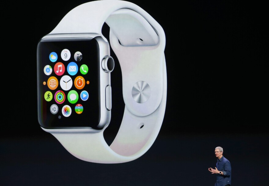 Apple CEO Tim Cook announces the Apple Watch Tuesday in Cupertino, Calif. Apple unveiled the long-awaited smart watch, which comes in two sizes and requires an iPhone.