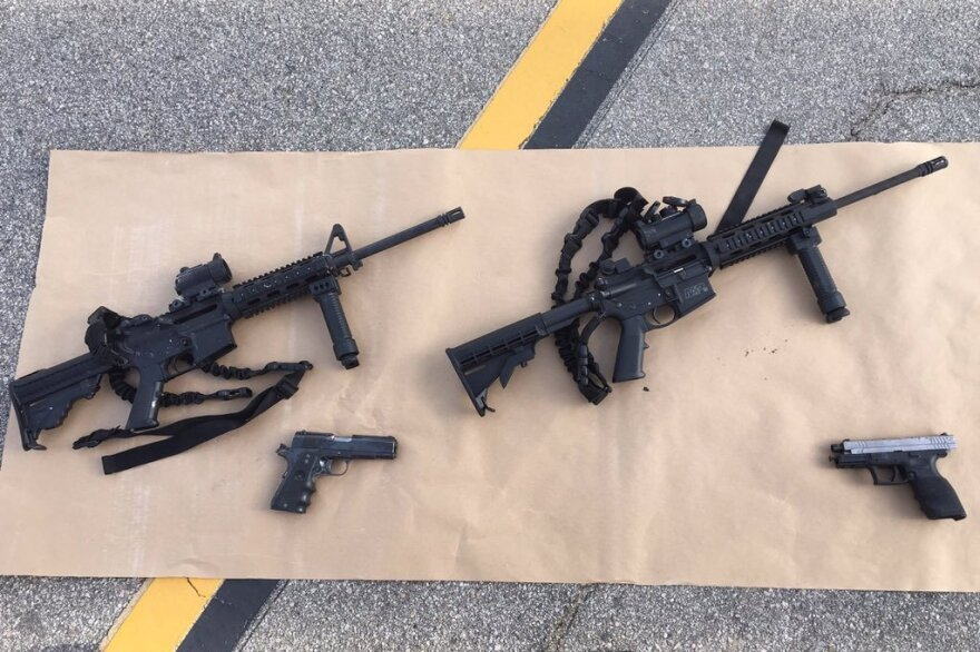 This image, released by the San Bernardino County Sheriff's office, shows some weapons and ammunition that were carried by the suspects in Wednesday's shooting.