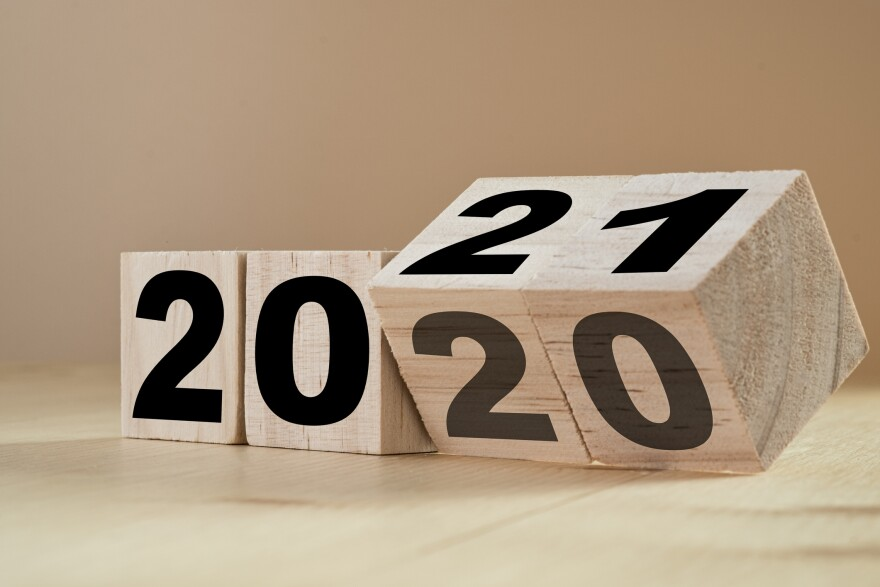 Flipping wooden cubes for the New Year change from 2020 to 2021. (Getty Images)