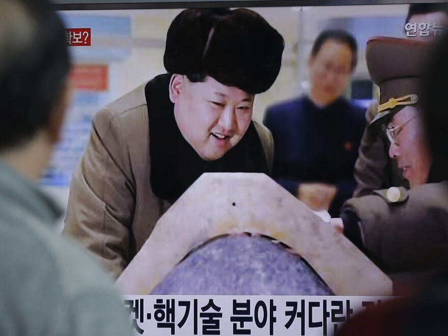 People watch a TV screen showing North Korean leader Kim Jong Un during a news program, at Seoul Railway Station in Seoul on Tuesday.