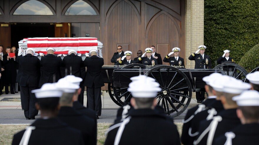 Navy honor guard teams participate in services to honor two sailors from the Civil War ship the USS Monitor on Friday in Arlington, Va.