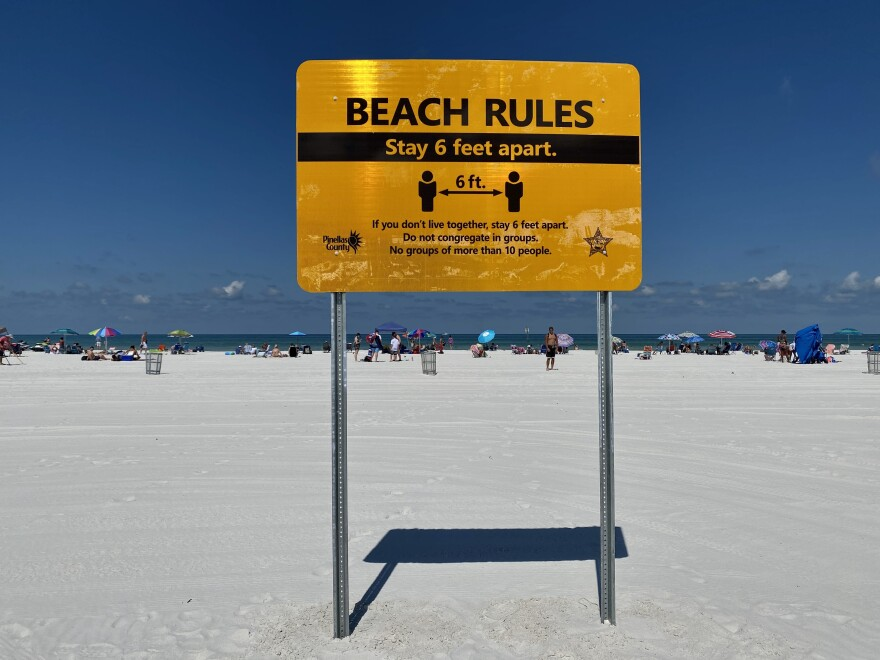 Clearwater Beach with social distancing sign