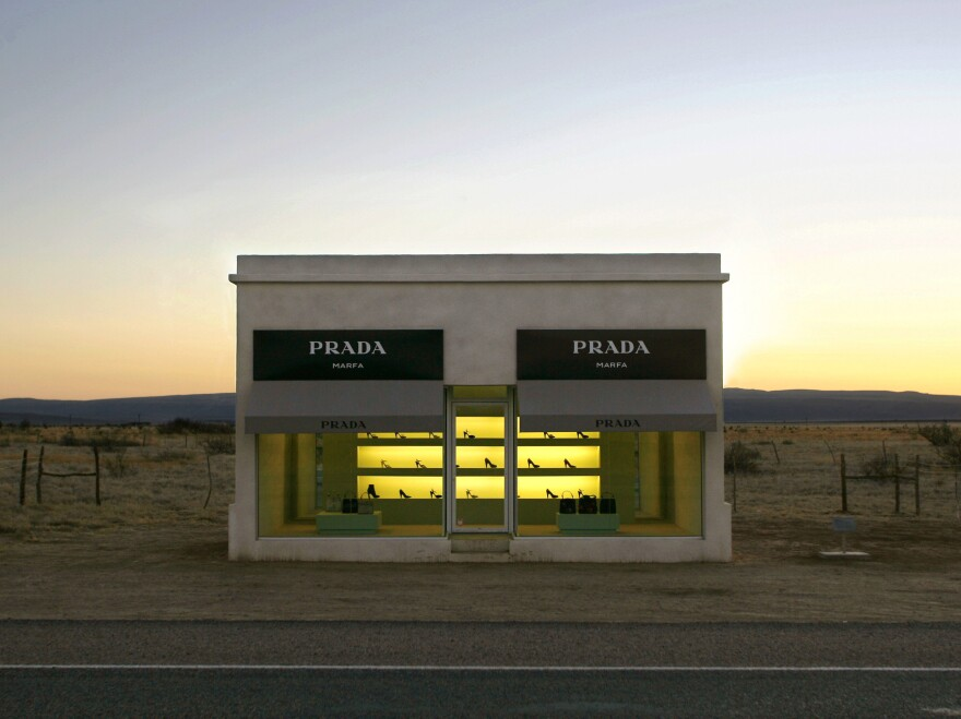 <em>Prada, Marfa</em> is a faux boutique displaying luxury bags and shoes in the middle of the sparse Texas landscape. It was created in 2005 by artist duo Michael Elmgreen and Ingar Dragset.