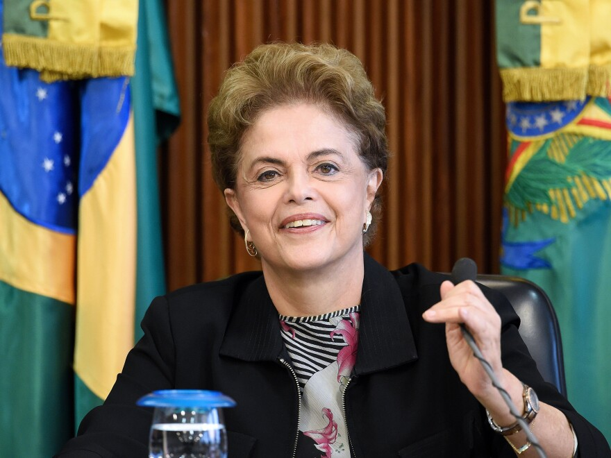 Brazilian President Dilma Rousseff, shown here at a meeting with rectors of public universities in Brasilia on March 11, is facing impeachment proceedings over her handling of the economy.