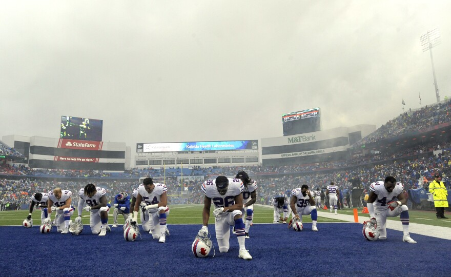 Buffalo Bills players take a moment to themselves prior to an NFL football game in Orchard Park, N.Y., on Oct. 29.