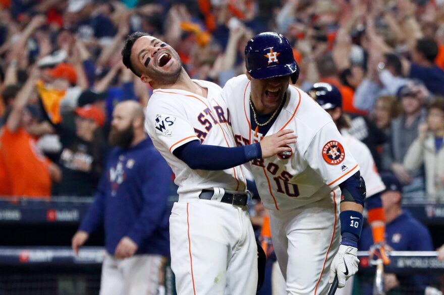 Jose Altuve and Yuli Gurriel of the Houston Astros celebrate after a two-run home run by Carlos Correa during the seventh inning against the Los Angeles Dodgers in Game 5 of the 2017 World Series at Minute Maid Park on Oct. 29, 2017 in Houston, Texas. (Jamie Squire/Getty Images)