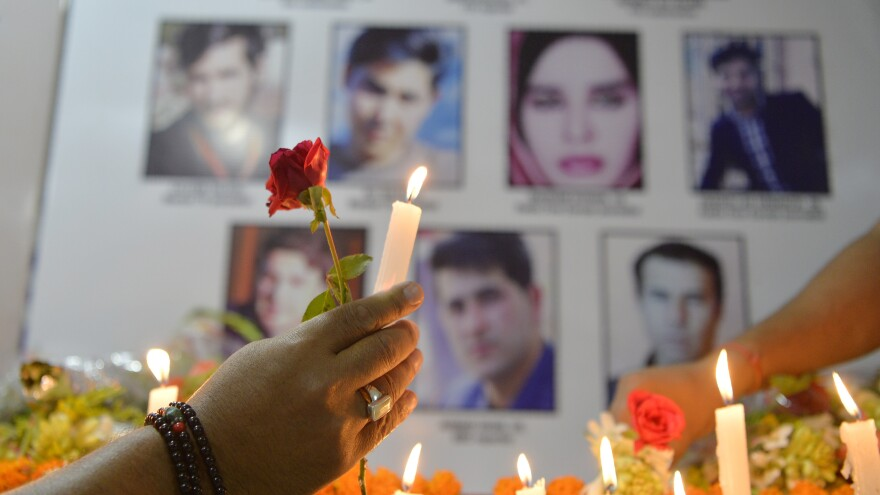 Journalists light candles in Siliguri, India, on May 3, during a vigil for Afghan journalists who were killed in a targeted suicide bombing in Kabul on April 30.
