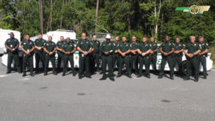 Clay County Sheriff Darryl Daniels with other deputies pose during a video