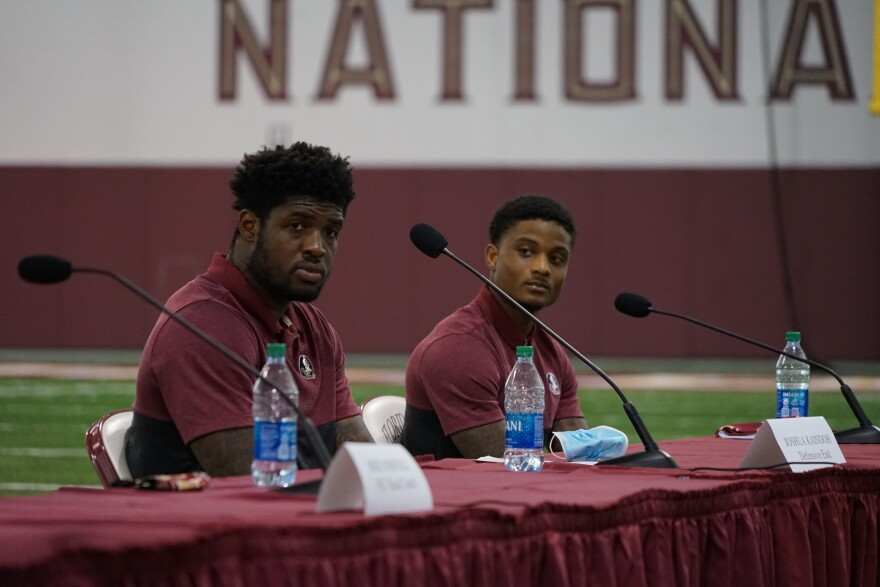 Florida State University defensive end Joshua Kaindoh, left, and wide receiver Keyshawn Helton joined Governor Ron DeSantis and university officials in calling for football games to be played this fall during a roundtable discussion August 11, 2020.