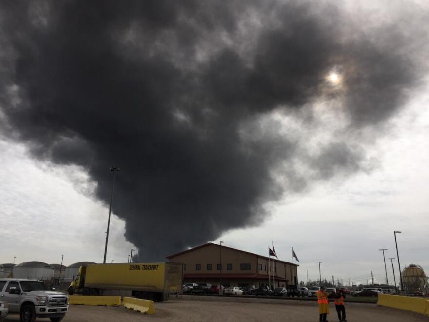 A large black plume of smoke