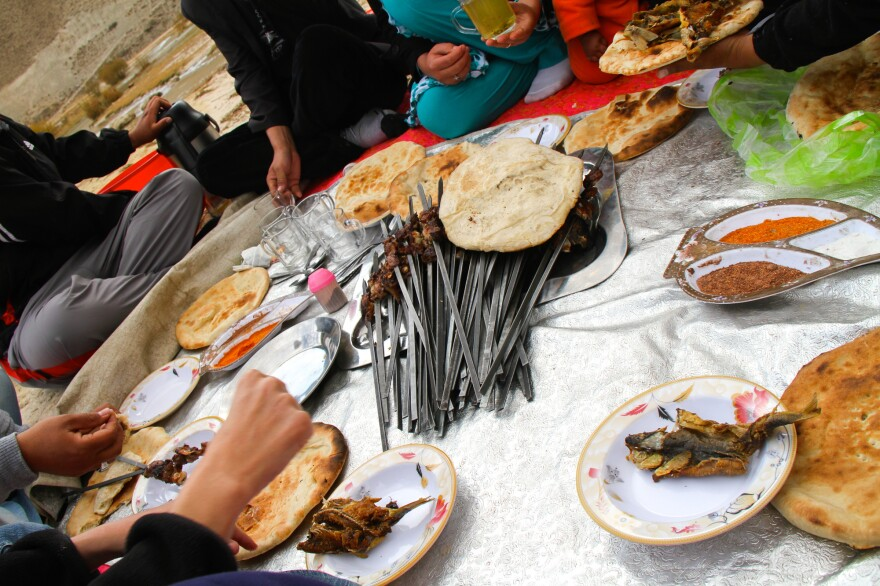 A picnic held in Band-e-Amir National Park, Bamiyan, Afghanistan in 2012. Traditionally, Nowruz marks the start of picnic season in Afghanistan.