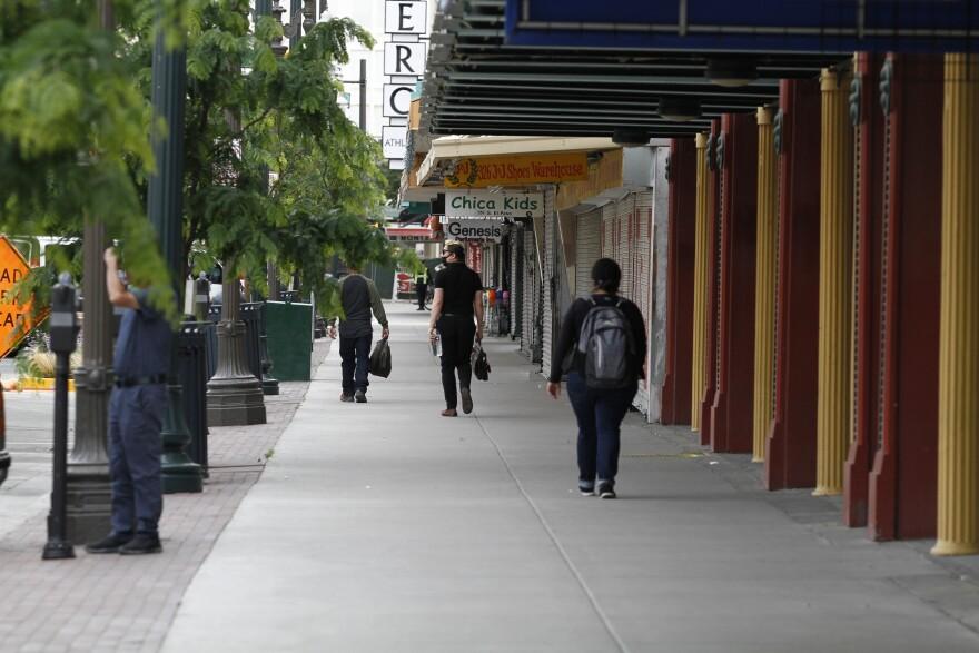 Sergio Soriano walks down a street in El Paso.