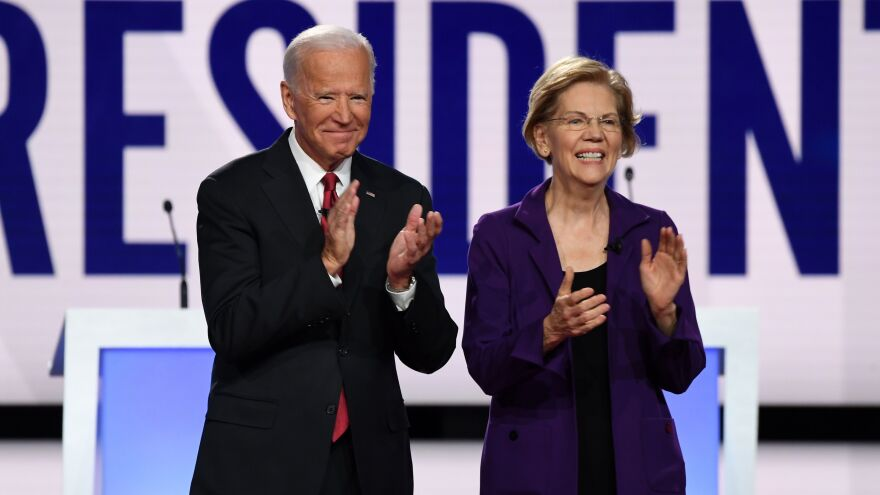 Former Vice President Joe Biden and Massachusetts Sen. Elizabeth Warren appear before a Democratic primary debate in Ohio last year.
