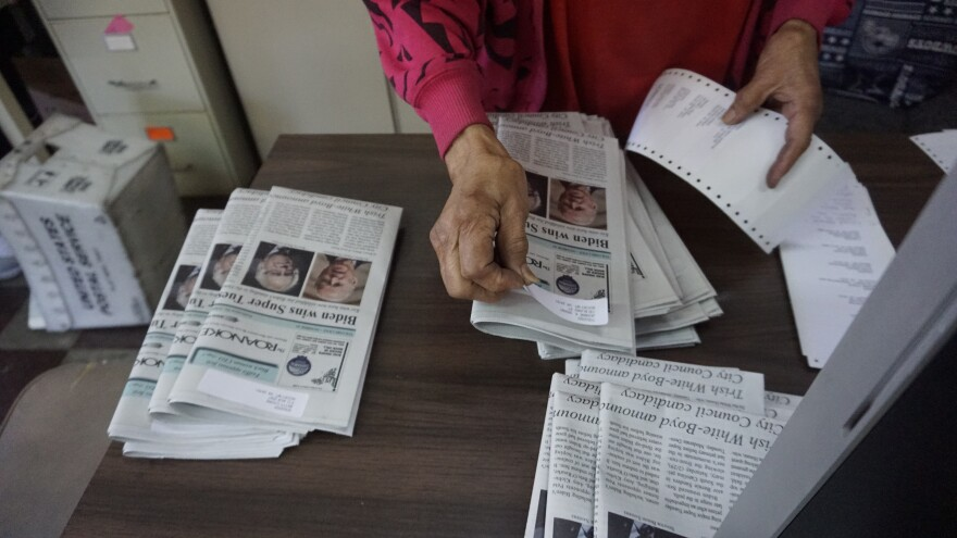 Roanoke Tribune publisher Claudia Whitworth places mailing labels on issues of the Roanoke Tribune, in preparation for mailing.