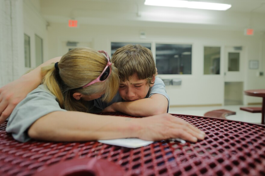 """Vinny, at age 13, cries during a visit with his mother, Eve, at the Bernalillo County Juvenile Detention Center in Albuquerque, New Mexico. """"Mom, just get me out,"""" he says. Vinny was incarcerated for stabbing his mother's assailant: """"When my mom was being beat up, I was so scared. I wanted to defend my mom."""""""