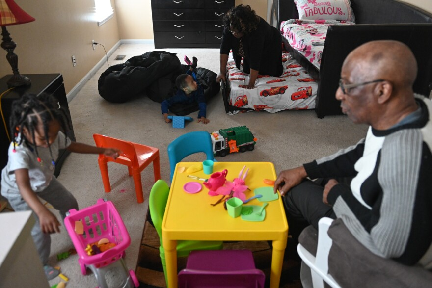 Wilma and Howard Walker enjoy playtime with their grandchildren.