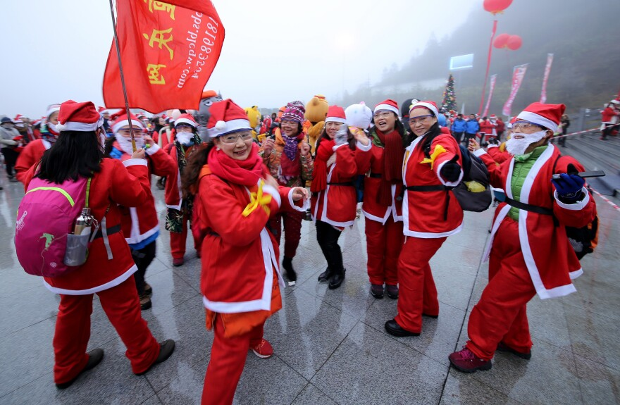 People dressed as Santa Claus compete in a run to mark Christmas at Xiannu Mountain in Chongqing, China. Even though only about 5 percent of the population is Christian, many people celebrate during the holiday.