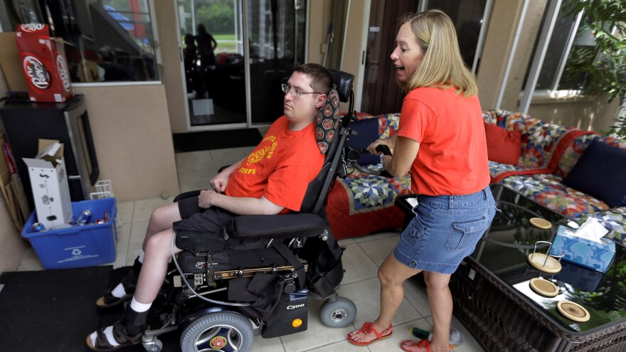 """Former Marine """"J.T."""" John Thomas Doody (left) was shot while serving in Fallujah, Iraq. His mother, Chris Ott (right), is also pictured in this 2013 Riverview, Fla. file photo."""