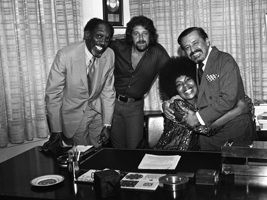 Flack (seated) with (from left) John Levy, Joel Dorn and Atlantic Records executive Nesuhi Ertegun in 1970.