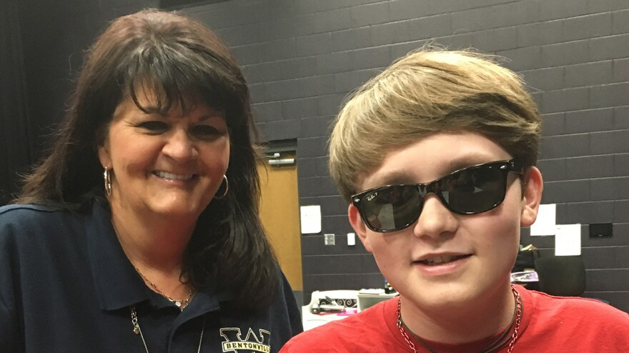 Rugenia Keefe, left, a paraprofessional who assisted Cole Phillips for most of high school after he lost his sight, spoke with the graduating senior for a remote conversation from Bentonville, Ark.