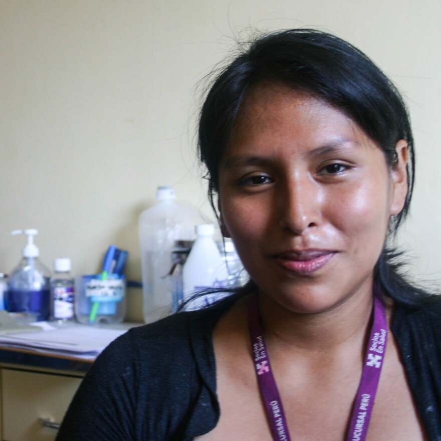 Diana Corolina Huamani Pasion is a TB nurse with Partners in Health in Lima, Peru. She'll greet a patient with a kiss on the cheek — levels of bacteria are very low after the drug regimen begins, she says.